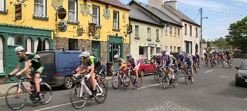 "Competitors in the  ""An Post"" cycle race coming through Athea last week on their way to the stage end in Listowel."