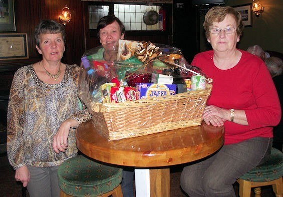 Patsy Hayes, Mag O'Connor & Maireád Langan looking after the spot prizes at the Going Strong Christmas Party