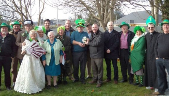 Councillor Francis Foley presenting the prize for 'Best Float'  at the St. Patrick's Day Parade in Abbeyfeale to Francis Flavin on behalf of Athea Drama Group and Athea Wren Boys