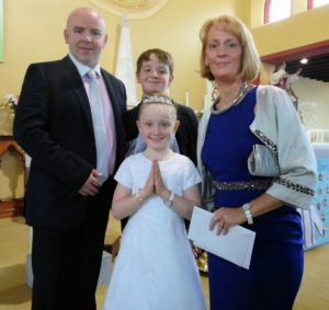 Derek & Tina Byrne with their son Adam and daughter Katie who made her communion last Saturday in Athea.