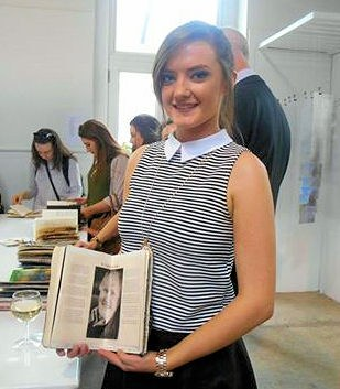 Sarah Prendeville holding the Visual Journal which she created for her Art project in college.
