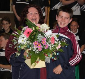 Eoghan Sheehan, on behalf of the Athea Féile team & parents, presenting a bouquet of flowers to Jacqueline O'Connor for all her hard work during the Féile weekend.