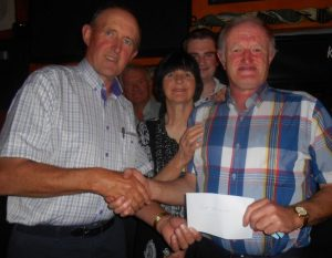 Jim Prendeville, Treasurer of Killeaney AFC presents Jim  Lynch and family with his cheque of €26,200 which he won last week in the Killeaney Lotto.